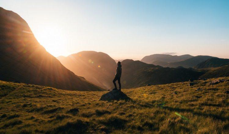 man on a hike, travel, sunset