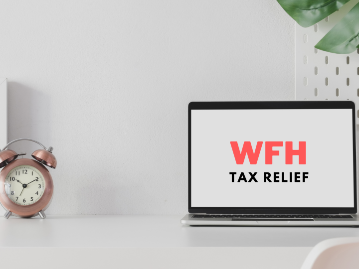 desk with clock on left hand side and open laptop with text 'WFH Tax Relief' written on the screen. A plant on top right hand side corner